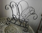 Gorgeous vintage scrolly wrought iron aged and rusty magazine rack