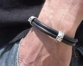 men black leather bracelet with sterling silver plated skull spacer