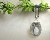 Silver wire wrapped pendant with moonstone - metalwork  wirework