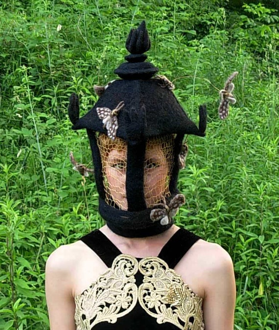 MOTH LAMP HAT  -- Needle Felted Wool with golden crochetted light panels that moths are swarming around.