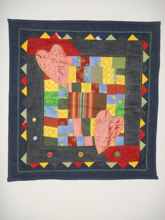 Heart blue denim quilt. Recycled.Decor-Applique, patchwork, machine stitches,yarn, buttons, patchwork corners. Size 19.5x21