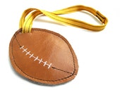 Rugby Ball Shaped ochre leather Luggage Tag SALE