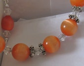 Orange Catseye Creamsicle bracelet - Upcycled Materials