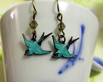 Patina sparrow dangle earring with smoky glass beads