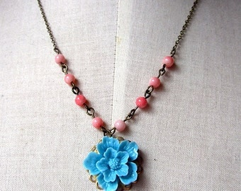 coral pink beads with Blue sakura cabochon necklace