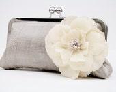 Flower embellished clutch bag