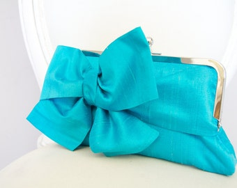 Turquoise bow clutch bag