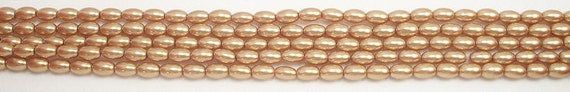 4x6mm Gold Rice Shaped Glass Pearls One 16 inch strand