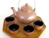 Saki Teapot, Cups and Wicker Serving Tray