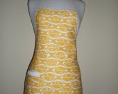 HOSTESS APRON  in a cotton drill fabric.with lemon citrus print.