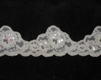 Ivory heavily Beaded Alencon Lace trim