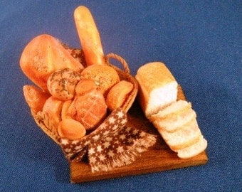 Breadboard with basket of assorted breads and sliced loaf