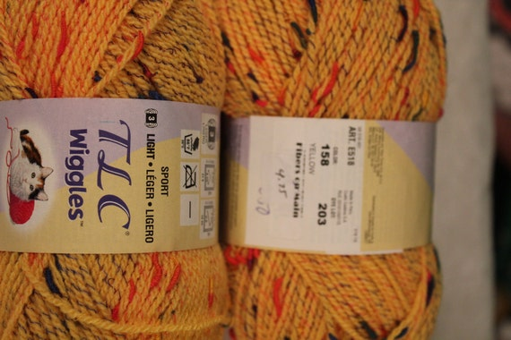 3 skeins TLC Wiggles Acrylic yarn gold variegated. 250 yds each