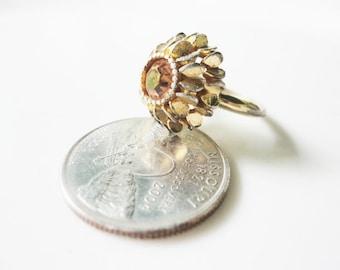 vintage Adjustable AVON goldtone ring with large  amber rhinestone