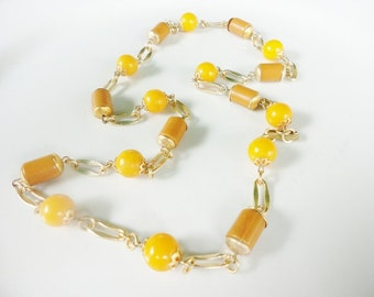 vintage statement necklace gold orange and brown spaced beads signed Hong Kong