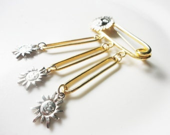 gold and silver color metal large security pin brooch with dangling sun
