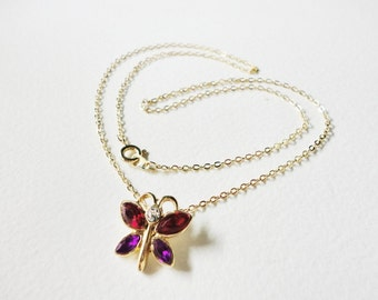 vintage little butterfly necklace with red and purple wings on a goldtone chain
