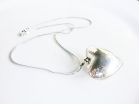 vintage necklace with puffy heart pendant in a silvertone retro jewelry
