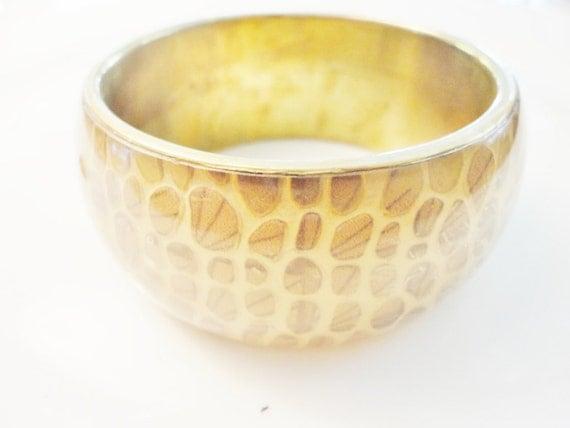 vintage big wide bangle bracelet in a goldtone with animal print nature inspired