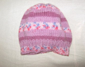 a pink multi colored beanie