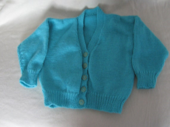 A LIGHT TEAL GREEN CHILDS CARDIGAN