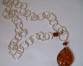 Amber pendant on large chain necklace