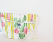 Ethnic pattern Ikat print pouch in pink, yellow, green with ceramic button