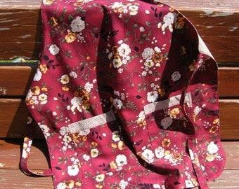 Floral on burgandy apron