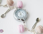 Watch with pink and cream macaroons