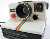 hipster 70s Polaroid sx-70 one step land camera with rainbow racing stripes and red button