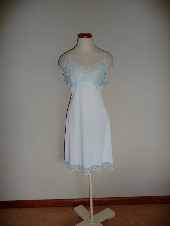 Vintage Ice blue nylon and chantilly illusion lace full slip by Hollywood Vassarette, size 38