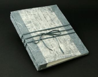 Grey blank soft bound book
