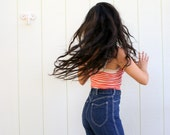 1970s high-waisted jeans . straight leg dark denim