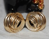 Gold Trifari Swirl Clip On Earrings at Chat Noir Studio