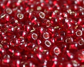 10 grams of 6/0 sized Silver-Lined Garnet TOHO seed beads (TH012)