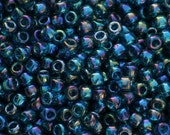 10 grams of 8/0 sized Trans-Rainbow Teal TOHO seed beads (TH059)