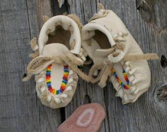 Beaded newborn moccasins ,   Newborn baby moccasins ,   Soft sole baby shoes