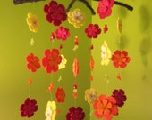 Flowers falling from above, in red, orange and yellow, all wool mobile