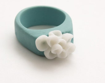 Porcelain pastel turquoise ceramic ring with cluster white pods flowers - Los Cabos, ceramic custom handmade fashion porcelain jewelry