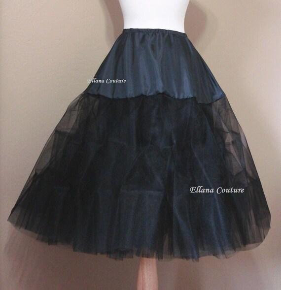 Black Tea Length Crinoline. Medium Fullness. Designed specifically for Tea Length Dresses. Available in Other Colors.