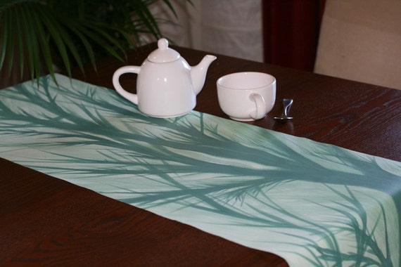 Turquoise trees on table runner