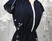 Free as a Bird on a Vintage Navy and White Dress