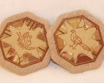 Butterfly and bird coasters in earth tones