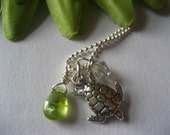 in the sea. sterling silver and genuine peridot necklace