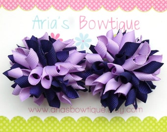 A Pair Of Light Lavender and Purple Mini Korkers