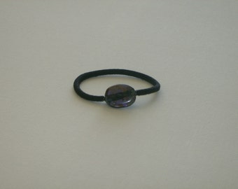 Purple oval Czech glass bead, with Picasso stone finish, ponytail holder
