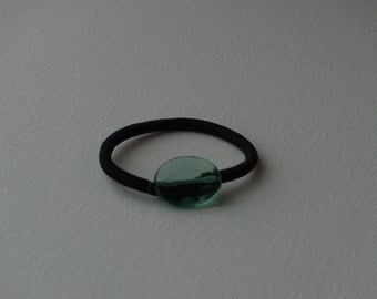 Faceted green oval glass bead, ponytail holder