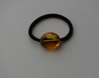 Faceted golden yellow oval bead, ponytail holder