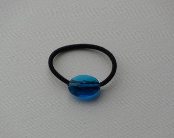 Faceted blue oval bead, ponytail holder