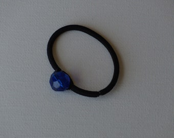 Faceted blue round glass bead, ponytail holder